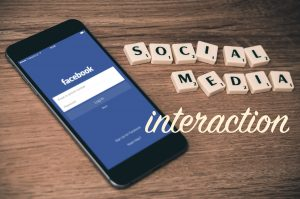 Social media interaction title image showing the Facebook app on a smartphone